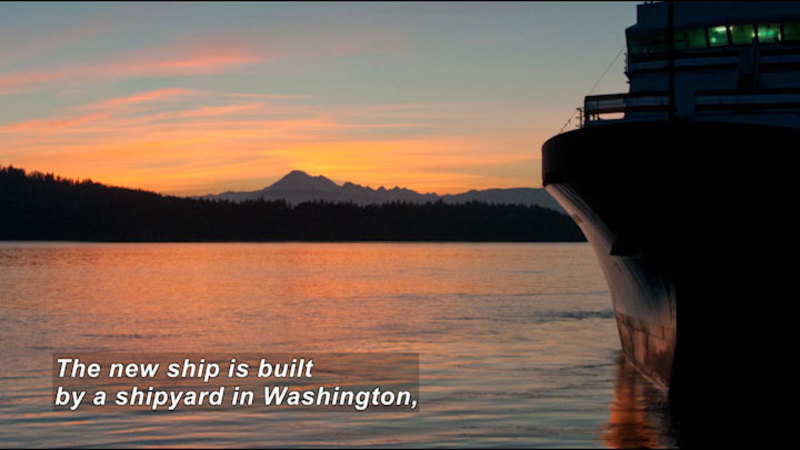 A large ship floating in the water. Caption: The new ship is built by a shipyard in Washington,