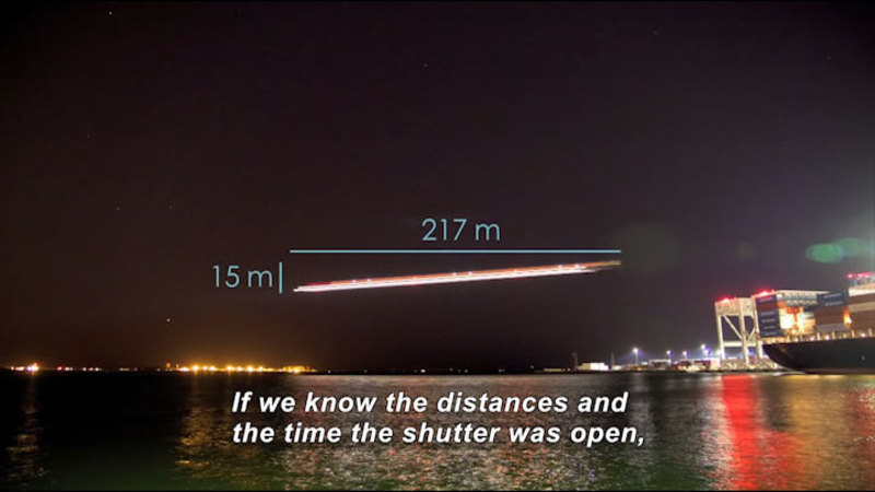 Streak of light across a night sky with a change in height of 15m and a length of 217m. Caption: If we know the distances and the time the shutter was open,