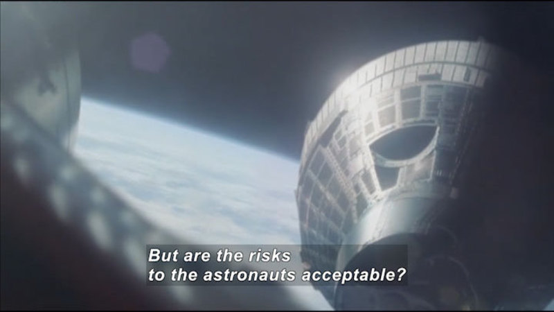 Part of a space craft as seen from space. Caption: But are the risks to the astronauts acceptable?