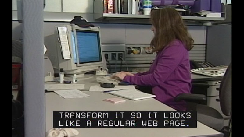 Still image from: Achieving Goals! Career Stories of Individuals Who Are Deaf and Hard of Hearing: Tech Savvy (Dawn Schakett, Web Developer)