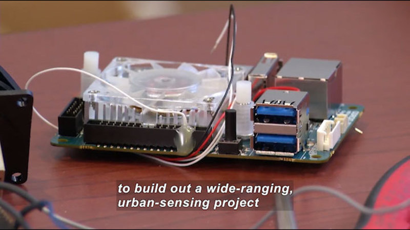 A computer drive. Caption: to build out a wide-ranging, urban-sensing project