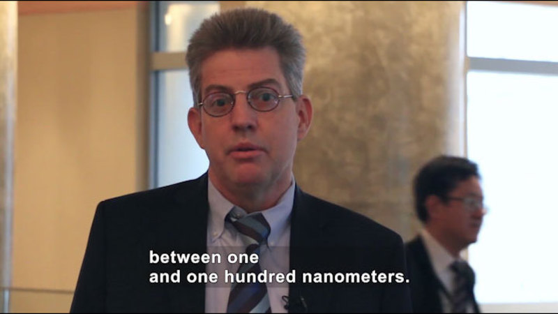 Person speaking. Caption: between one and one hundred nanometers.