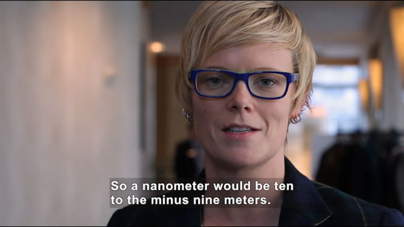 Person speaking. Caption: So a nanometer would be ten to the minus nine meters.