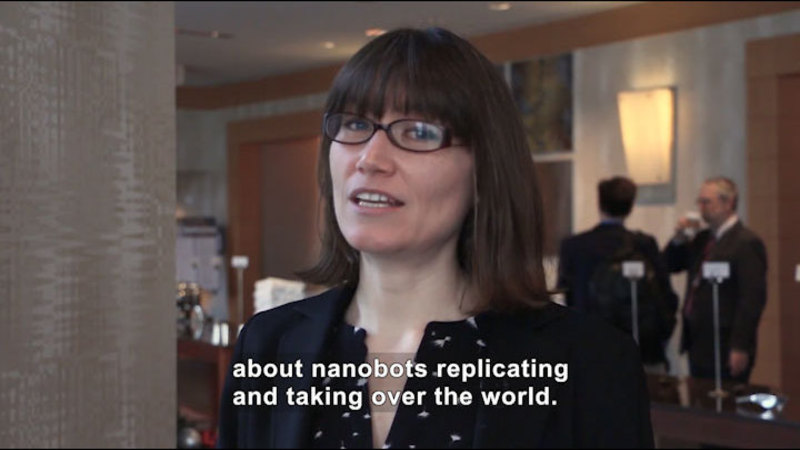 Person speaking. Caption: about nanobots replicating and taking over the world.