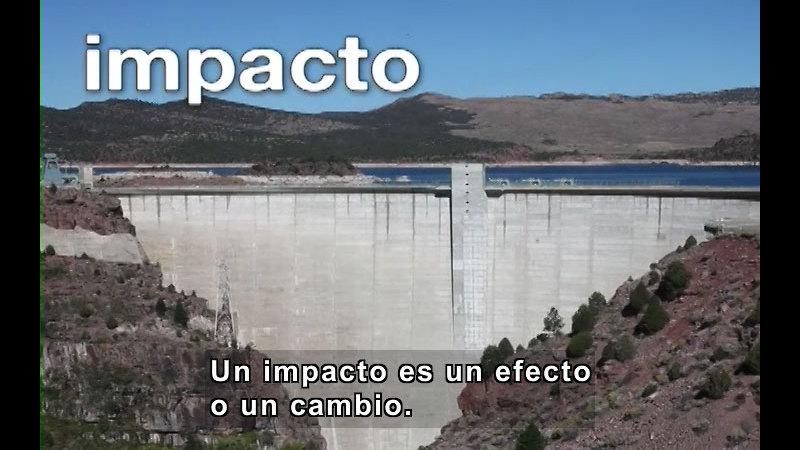 A manmade dam. Spanish captions.