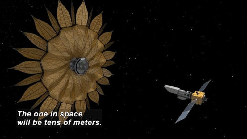 A roughly rectangular space craft with two solar wings approaches a much larger round spacecraft surrounded in petal-like protrusions. Caption: The one in space will be tens of meters.