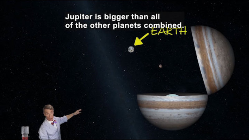 Planet Jupiter being shown next to Earth. Caption: Jupiter is bigger than all of the other planets combined.