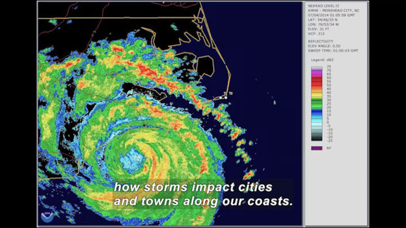 Satellite image of a hurricane. Caption: how storms impact cities and towns along our coasts.
