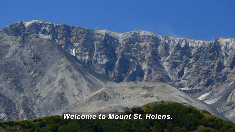 Rocky mountain covered in ash and rocks. Caption: welcome to Mount St. Helens.