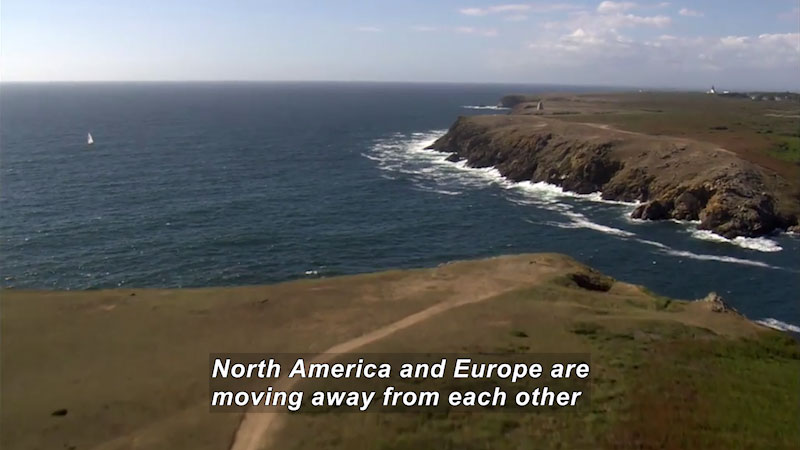 Coastline of two land masses with ocean in between. Caption: North America and Europe are moving away from each other