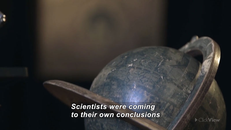 An old globe. Caption: Scientists were coming to their own conclusions