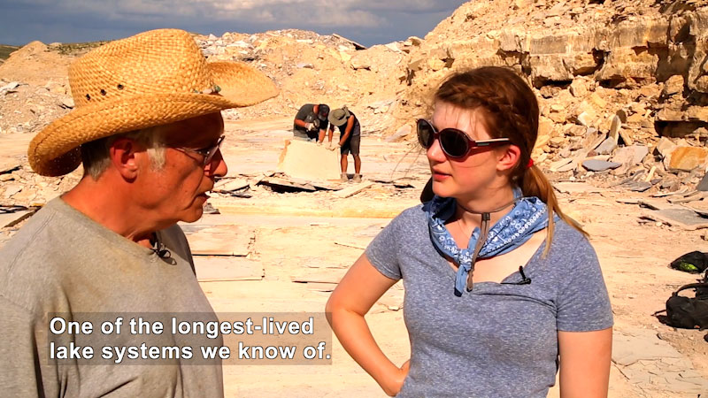 Host Emily talks to Lance Grande at the Fossil Lake in Wyoming. Caption: One of the longest-lived lake systems we know of