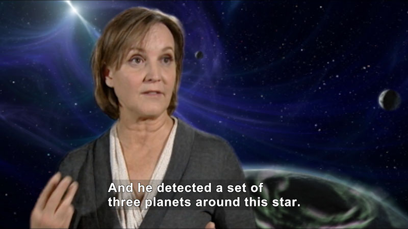 Person speaking in front of a background showing planets and space. Caption: And he detected a set of three planets around this star.