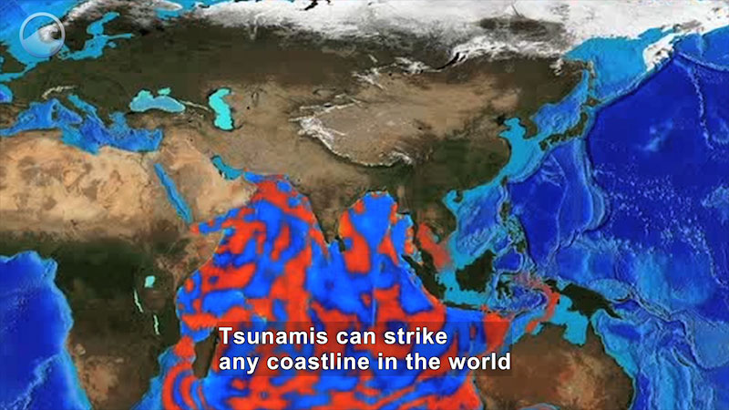 Map of Earth with Africa, Australia, Europe and Asia in view. The water on the map shows large portions highlighted in orange. Caption: Tsunamis can strike any coastline in the world