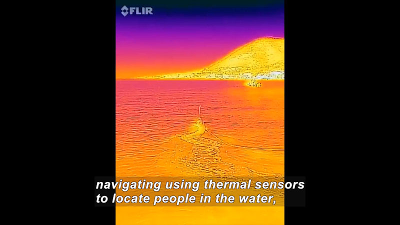 Body of water in shades of red, yellow, range, and pink showing heat gradients. Caption: navigating using thermal sensors to locate people in the water,