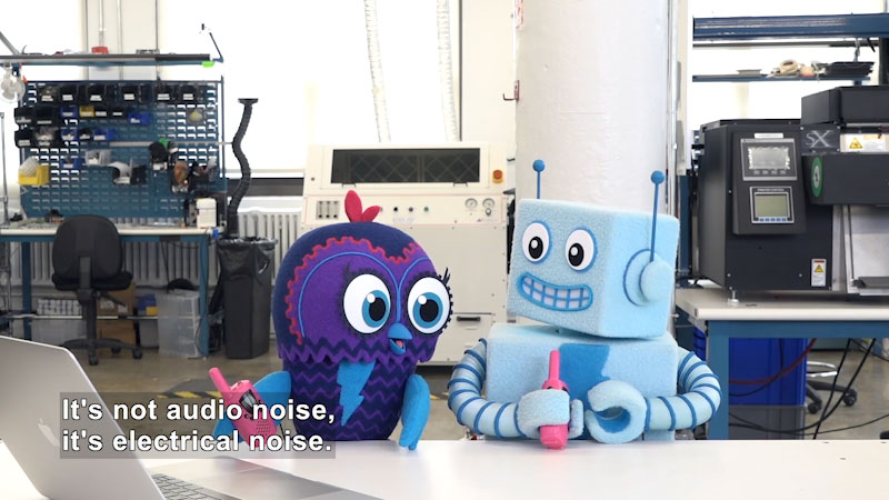 Robot and bird with walkie-talkies in a workshop. Caption: It's not audio noise, it's electrical noise.