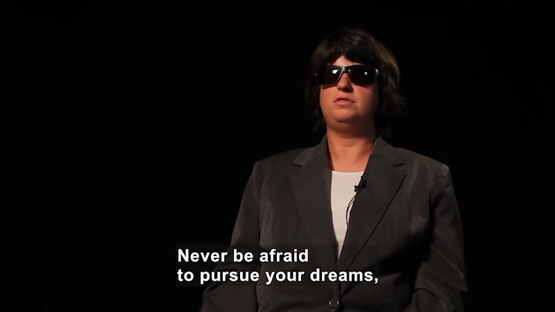 Woman wearing dark sunglasses. Caption: Never be afraid to pursue your dreams,