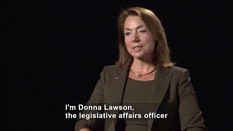 Woman speaking. Caption: I'm Donna Lawson, the legislative affairs officer