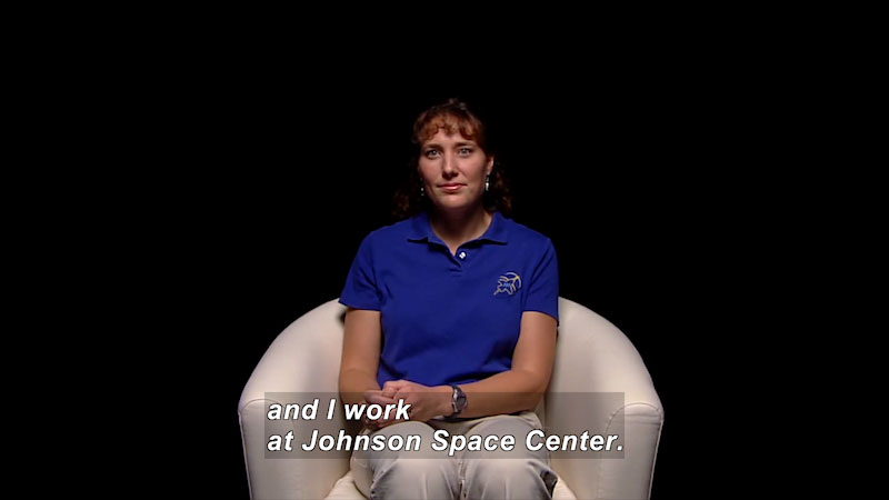 Woman sitting in a chair. Caption: and I work at Johnson Space Center.