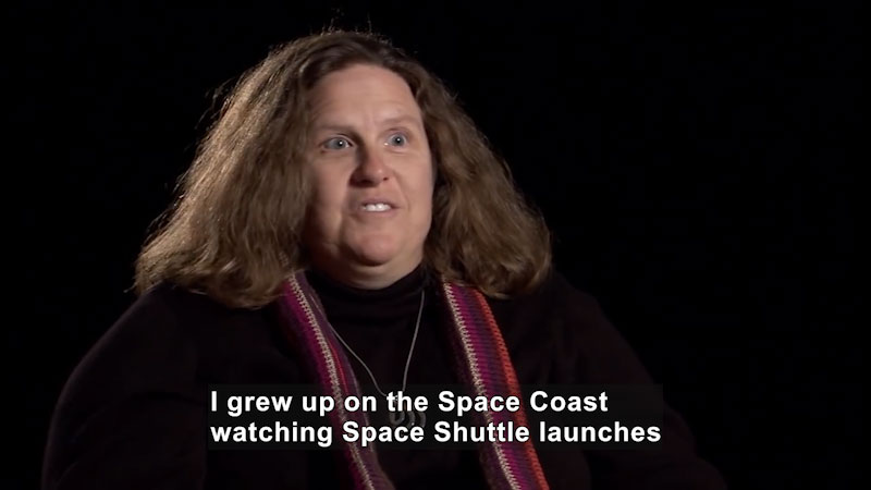 Woman speaking. Caption: I grew up on the Space Coast watching Space Shuttle launches