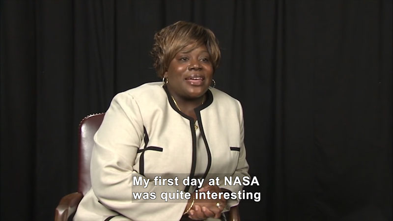 Woman speaking. Caption: My first day at NASA was quite interesting