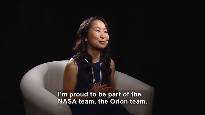 Woman speaking. Caption: I'm proud to be part of the NASA team, the Orion team.