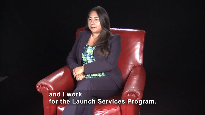 Woman speaking. Caption: and I work for the Launch Services Program.