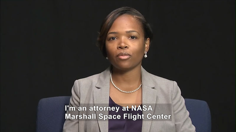 Woman speaking. Caption: I'm an attorney at NASA Marshall Space Flight Center