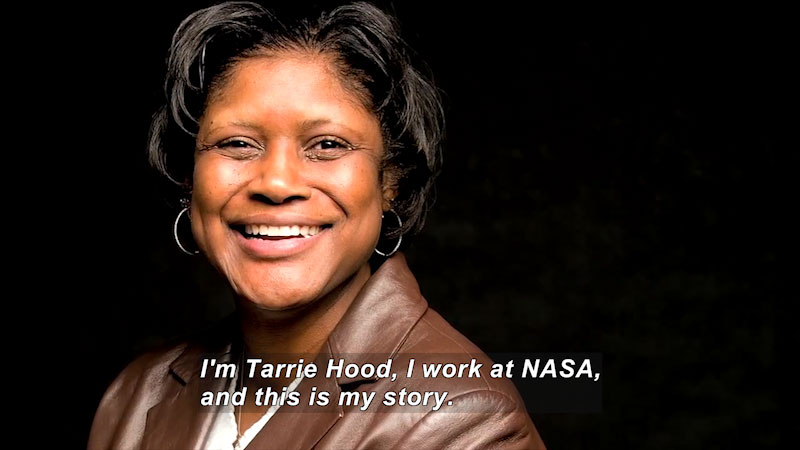 Woman speaking. Caption: I'm Tarrie Hood, I work at NASA, and this is my story.