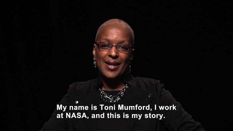 Woman speaking. Caption: My name is Toni Mumford, I work at NASA, and this is my story.