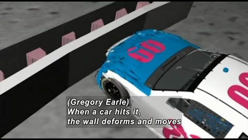 A simulation of a car crash on a wall. Caption: Gregory Earle, When a car hits it, the wall deforms and moves.