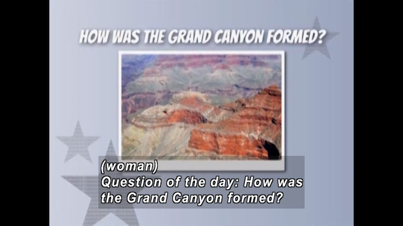 Layers of red sedimentary rock forming the cliffs to the Grand Canyon. Caption: (woman) Question of the day: How was the Grand Canyon formed?