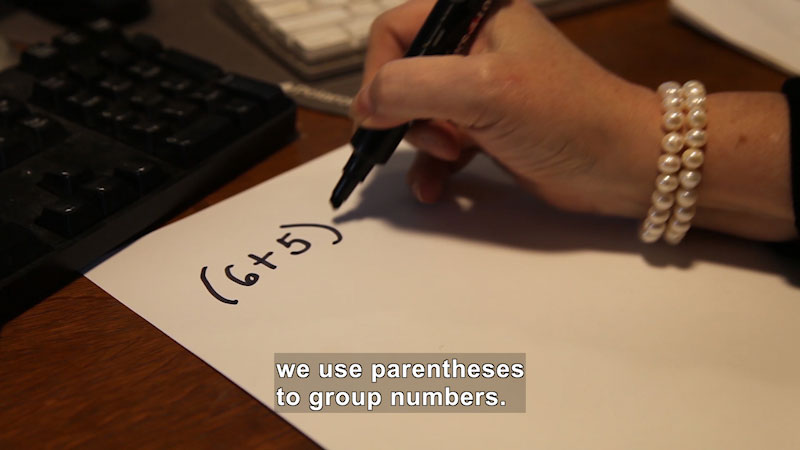 Still image from: Properties of Numbers