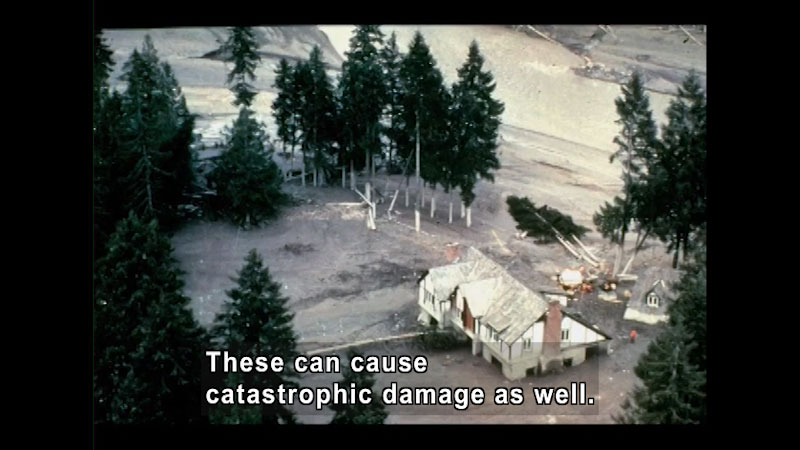 Aerial view of destroyed house and fallen trees. Caption: These can cause catastrophic damage as well.