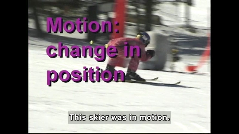 Person on skis in a crouched position. Motion: change in position. Caption: This skier was in motion.