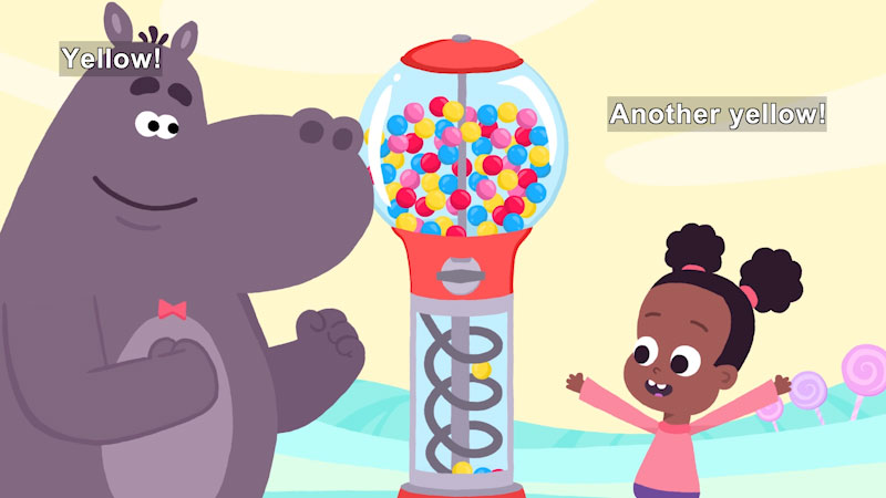 Cartoon of a girl and a second character next to a gumball machine. The machine has a yellow gumball descending the chute. Caption: Yellow! Another yellow!