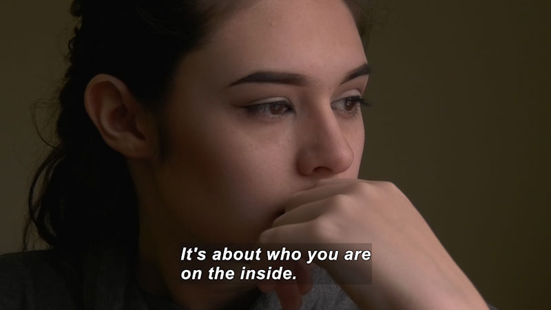 Closeup of a young woman's face. Caption: It's about who you are on the inside.