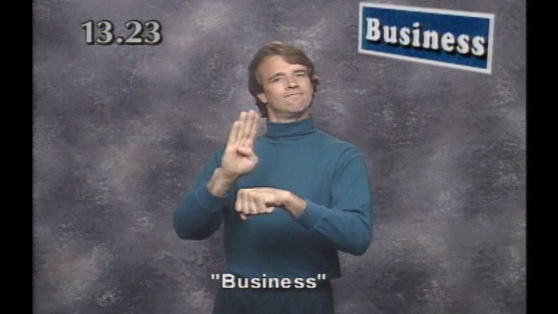 Still image from: Beginning ASL Videocourse #13: Business as Unusual