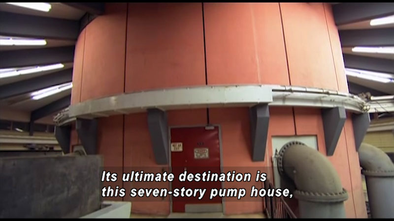 A seven story pump house. Caption: Its ultimate destination is this seven story pump house,