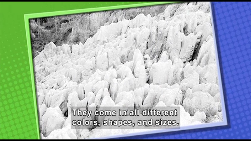 A photograph of snow capped rocks. Caption: They come in all different colors, shapes, and sizes.
