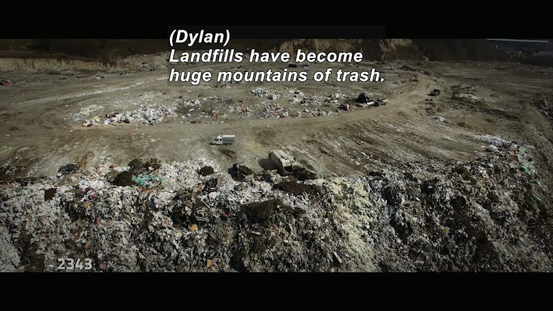 A large landfill. Caption: Dylan, Landfills have become huge mountains of trash.