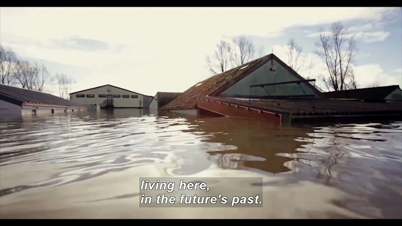 A flooded neighborhood. Caption: living here, in the future's past.
