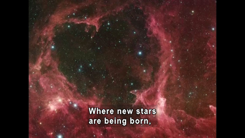 The celestial image of a red starry surface. Caption: Where new stars are born,