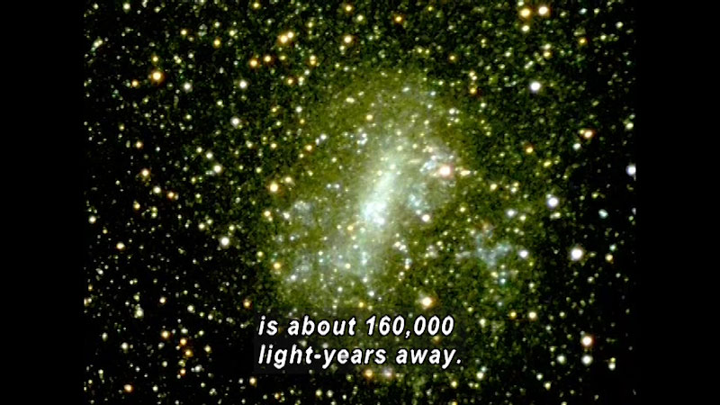 Image of Andromeda galaxy. Caption: is about 160,000 light years away.