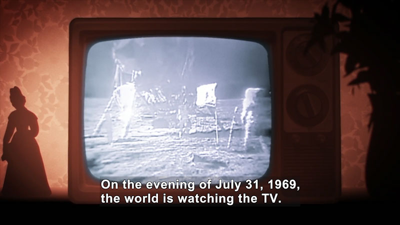 A T V screen displays men walking on the moon. Caption: On the evening of July 31, 1969, the world is watching the T V.