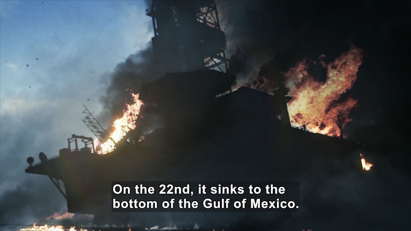 A burning ship. Caption: On the 22nd, it sinks to the bottom of the gulf of Mexico.