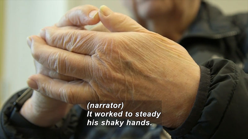 Hands of an elder person. Caption: (narrator) It worked to steady his shaky hands.