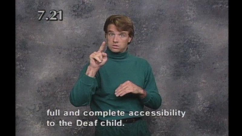 Still image from Beginning ASL Videocourse #7: A School Daze
