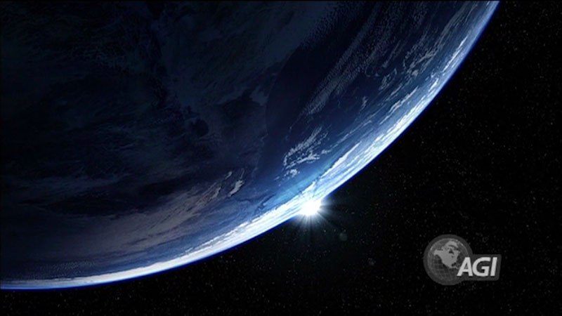 A Satellite image of the Earth. Sun is visible in the horizon.