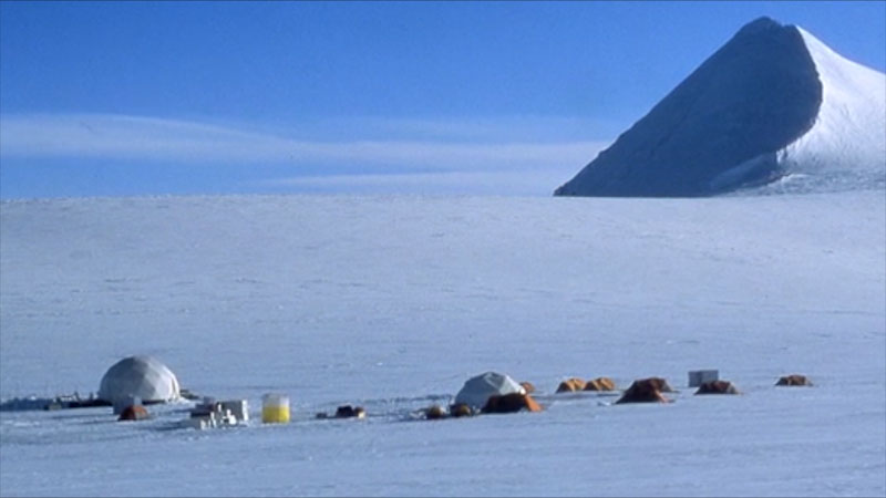 Igloos and tents are built on a glacier.